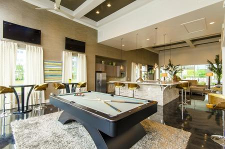 Residents Playing Pool | Conroe Apartments | The Towers Woodland