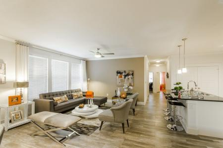 Residents Lounging in the Living Room | Apartments In Conroe Texas | The Towers Woodland