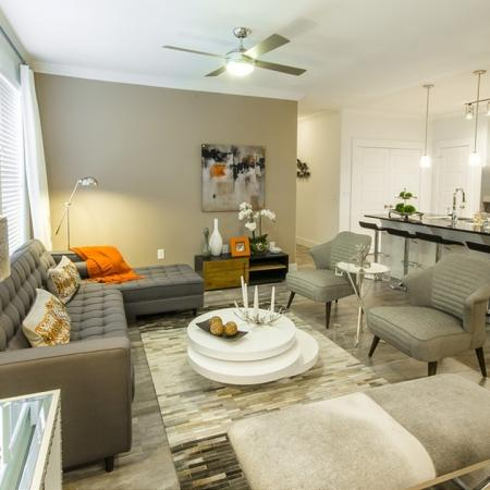 Residents Lounging in the Living Area | Apartments Conroe | The Towers Woodland
