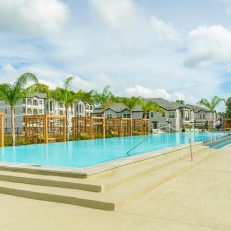 Tanning by the Pool | Apartments Conroe TX | The Mansions Woodland