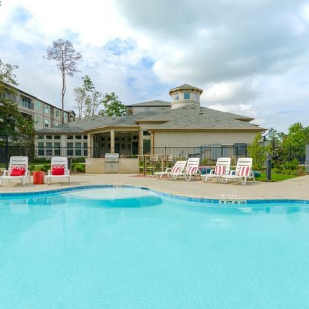 Lounging by the Pool | Conroe Texas Apartments | The Grand Estates in the Forest