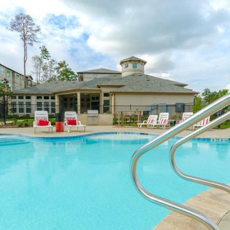 Tanning by the Pool | Apartments In Conroe TX | The Grand Estates in the Forest