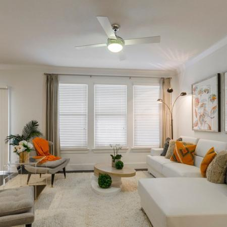 Residents Lounging in the Living Room | Seabrook Apartments TX | The Towers of Seabrook