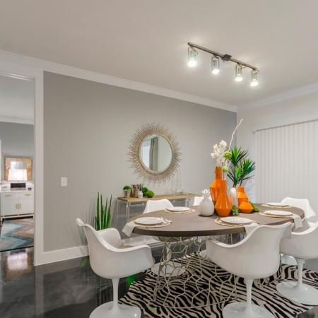 Residents Having Dinner in the Dining Room | Apartments Seabrook TX | The Towers of Seabrook