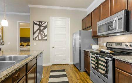Residents Snacking in the Kitchen   Apartments For Rent In Little Elm TX   The Estates 3Eighty