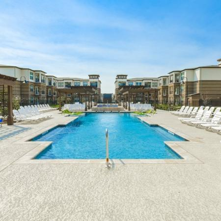 Tanning by the Pool | Luxury Apartments McKinney | The Mansions McKinney