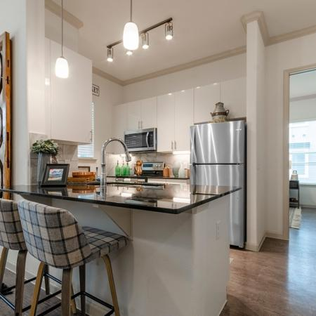Residents Cooking in the Kitchen | New Braunfels Apartments | The Luxe at Creekside