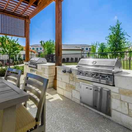 Community BBQ Grills | Apartments In Garland TX | The Mansions at Spring Creek