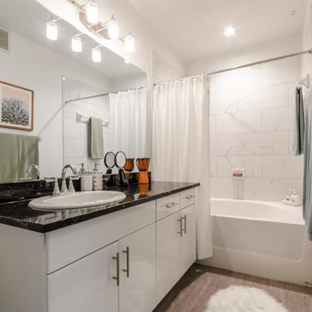Elegant Spacious Bathroom   Apartments In Garland TX   The Mansions at Spring Creek