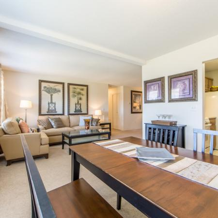 The beautiful dining and living areas of our apartments for rent in Nashua at Boulder Park