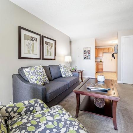 Gorgeous living room layout at Princeton Park apartments in Lowell MA