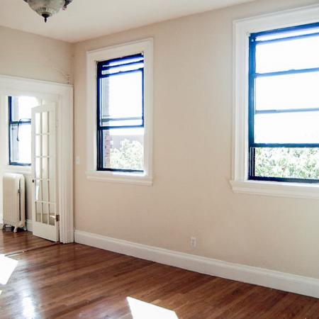 Airy living area with multiple windows | One Bedroom Apartments In Brookline MA | Princeton on Beacon Street