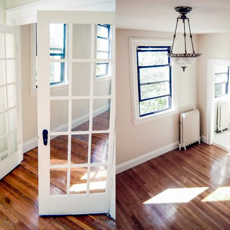 Open concept, light and airy interior with wooden-plank flooring at Princeton on Beacon St. apartments in Brookline, MA.
