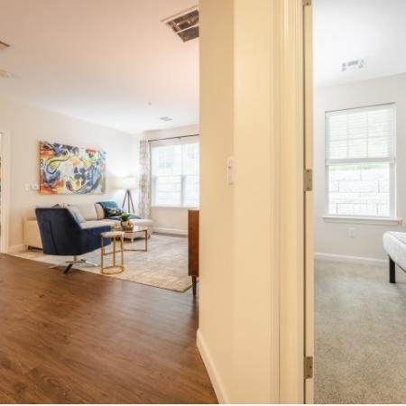 Spacious living room between two bedrooms at Mill & 3 Apartments  in Chelmford, MA.