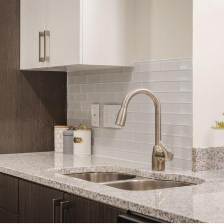 New Modern Kitchens with granite countertops and tile backsplash at Mill & 3 Apartments  in Chelmford, MA.