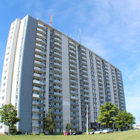 Westbury Apartments, exterior, building exterior, multi level, trees, blue sky, walkway, grassy area