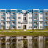 Venice Isles Apartments Exterior, well manicured grounds, water features, modern architecture