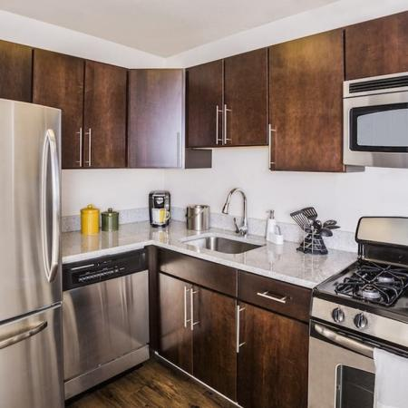 Upgraded Kitchen with Stainless Steel Appliances and Granite Counters | The View at Waterfront