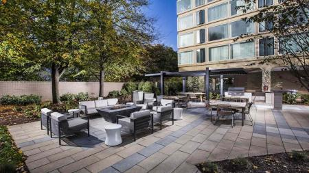 Outdoor Kitchen and Fire Table with Seating | The View at Waterfront