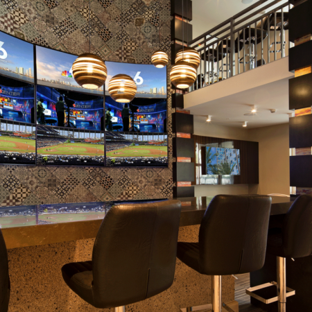 Sports Lounge with Flat Screen Televisions and Bar-Style Seating | Modera Douglas Station