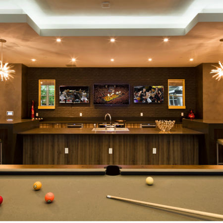Resident Clubhouse with Bar Seating and Pool Table | Modera Douglas Station