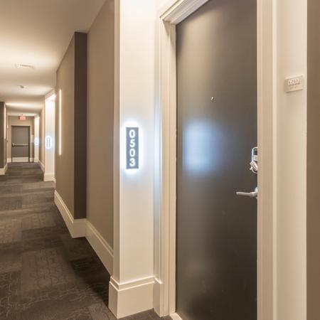 Backlit Apartment Numbers in Hallways | Modera Midtown