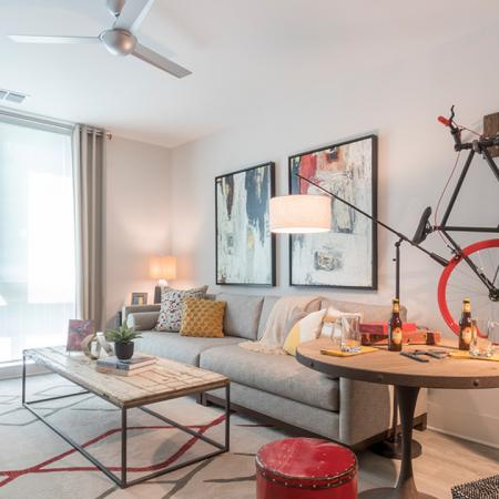 Modern Living Room with Nest Learning Thermostat and Steel Fan | Modera Midtown