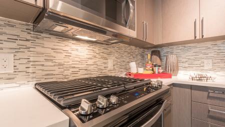 Tile Backsplash, Gas Cooktop and USB Ports in Kitchen | Modera Midtown