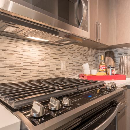 Tile Backsplash, Gas Cooktop and USB Ports in Kitchen | Modera Midtown