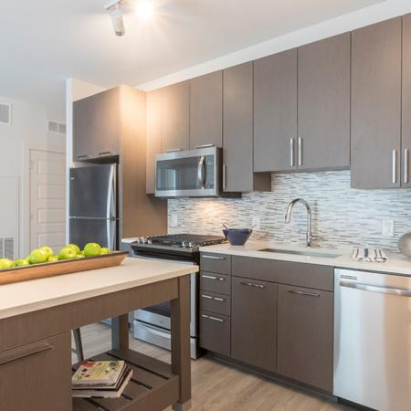 Kitchen Island with White Quartz Countertop in Modern Kitchen | Modera Midtown