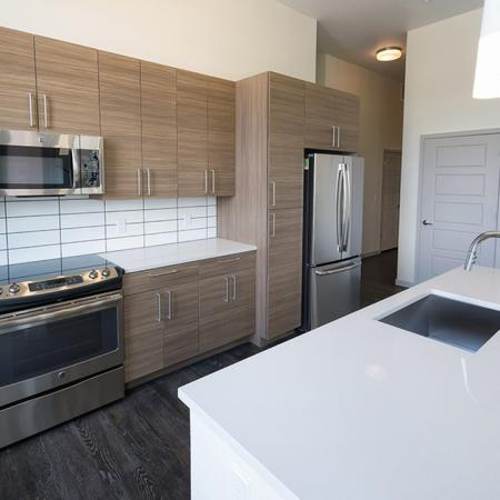 Breakfast Bar with White Quartz Countertop | Modera Observatory Park