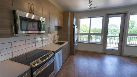 Studio Apartment with Wood Plank-Style Flooring and Private Balcony   Modera Observatory Park