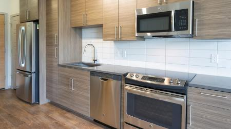 Stainless Steel and Custom Cabinets in our Studio Apartment Homes   Modera Observatory Park