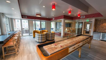 Shuffleboard and Social Seating in our Party Pod  Modera Observatory Park