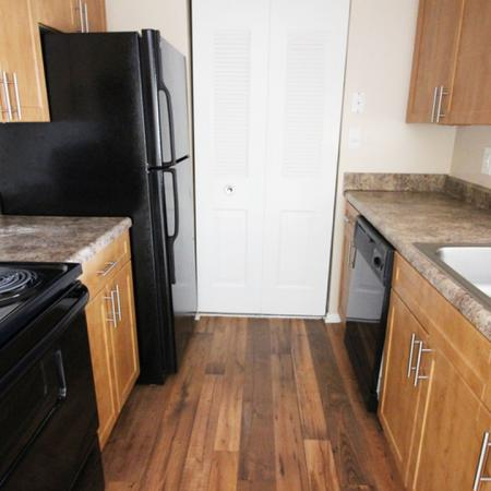 Residents Cooking in the Kitchen | Studio Apartments in Columbia MD | Alister Town Center Columbia