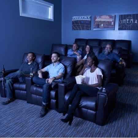 Residents Watching a Movie in Theatre Room | Waukee Iowa Apartment Homes | The Winhall of Williams Pointe