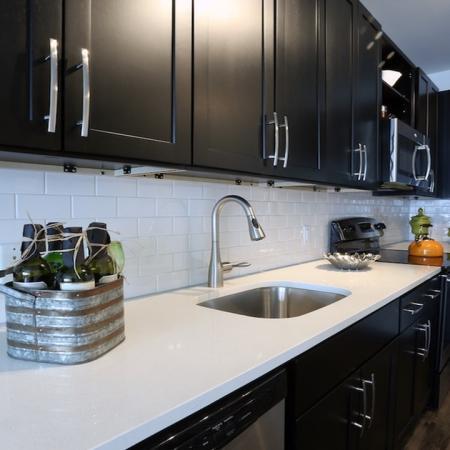 Sleek Subway Tile Backsplash and Quartz Counter in Modern Kitchen | Modera 44