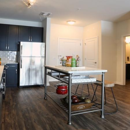 Open Kitchen with Full-Size Stackable Washer and Dryer in Closet | Modera 44