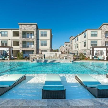 Outdoor Resort-Style Pool with Tanning Ledge | Modera Energy Corridor