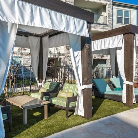 Relaxing Cabanas at Pool Deck | Modera Energy Corridor