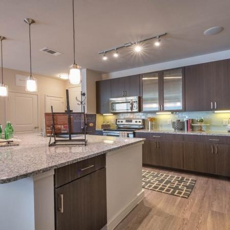 Spacious Kitchen with Custom Cabinets and Island | Modera Energy Corridor