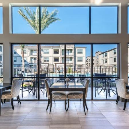 Dramatic Resident Clubhouse Overlooking Pool | Modera Energy Corridor
