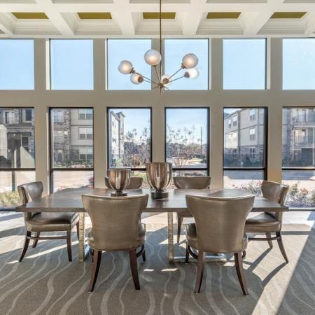 Resident Clubhouse Dining Table and Lounge | Modera Energy Corridor