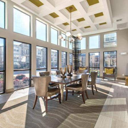 Spacious Clubhouse Room with Dining Table | Modera Energy Corridor