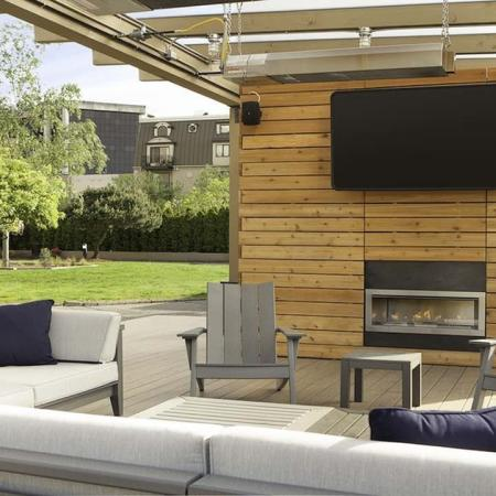 Outdoor Lounge with Flat Screen TV and Fireplace | Skye at Belltown