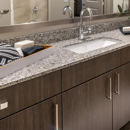 Bathroom Vanity with Modern Fixtures and Granite Counters | Modera Near the Galleria