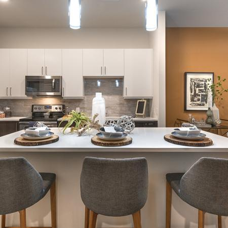 Spacious Kitchen with Chefs Island and Quartz Counters | Modera Near the Galleria
