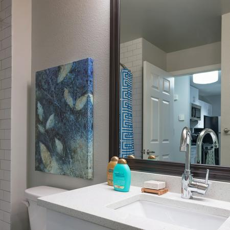 Redesigned Bathrooms with Granite Counters and Tile Surrounds | Alister Quincy