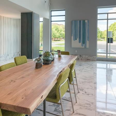 Oversized Wood Table in Lobby | Modera Medford