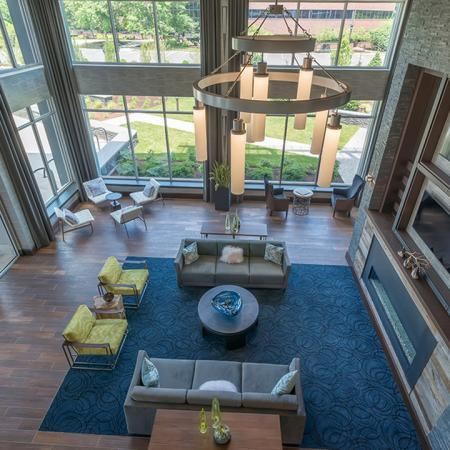 Resident Clubroom with Fireplace and Flat Screen Televisions | Modera Medford